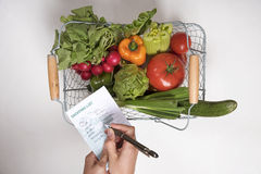SHOPPING LIST WITH A PEN AND SALAD PRODUCE Stock Photo