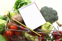 Shopping list with pencil, basket and vegetables Royalty Free Stock Images