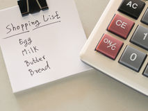 Shopping list. Pic of Shopping list with calculator Royalty Free Stock Photography