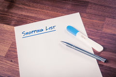 Shopping list of pregnant woman Stock Image