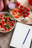 Shopping list on table. With a bunch of vegetables Royalty Free Stock Image