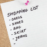 Shopping list. On wooden background Stock Images