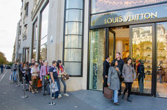 Shopping at Louis Vuitton in Paris Stock Images