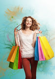 Shopping love. Young beautiful woman carrying colorful shopping bags having fun and smiling Stock Image