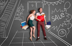 On shopping. Love story concept of a romantic couple on shopping against chalk drawings background. Young happy couple standing together with shopping bags in a vector illustration