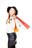Shopping love. Young woman holding shopping bags and looking away - isolated on white Stock Photo