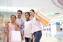 Shopping lovers. Asian family standing in front of shopping window Stock Images