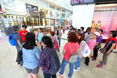 Shopping mail in Singapore . MBS. Tour group within MBS. Tour guide talking to tourist Royalty Free Stock Images