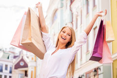 Shopping makes her happy. Royalty Free Stock Images