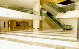 Shopping mall. Empty shopping mall interior and escalators stock photo