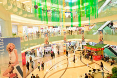 Shopping mall. Interior with many people in it at chengdu,china.This super mall is named JiuLong super mall.Photo is taken on 16 April 2011 Royalty Free Stock Images