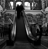 Shopping mall. Customers at shopping mall on the moving stairway, Magna Plaza, Amsterdam Stock Photography