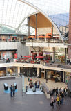 Shopping in the mall. Shoppers stroll through an indoor shopping mall on a fine day Stock Photography