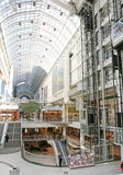 Shopping mall. Bright shopping mall center with open concept skylight