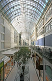 Shopping mall. Bright shopping mall center with open concept skylight Stock Images