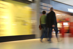 Shopping in a mall. Couple shopping in a mall, motion blur Stock Image