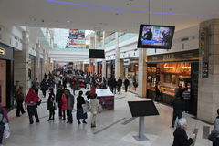 Shopping in crowded mall. Customers are walking and shopping in AFI Palace Cotroceni Mall in Bucharest, Romania Royalty Free Stock Photo