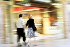 Shopping in a mall. Couple shopping in a mall, panning shot, intentional in-camera motion blur Royalty Free Stock Photography