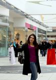 Shopping at the mall. A woman holding two bags at a large shopping mall in Scandinavia Stock Images