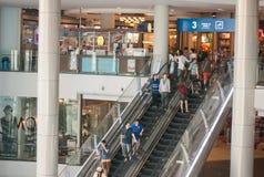 Shopping Mall Belt Escalator. People on belt escalator walking and shopping in a shopping Thailand mall Royalty Free Stock Image