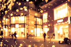 Shopping mall blur background with holiday lights Royalty Free Stock Image