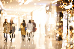 Shopping mall blur background with holiday lights Stock Images