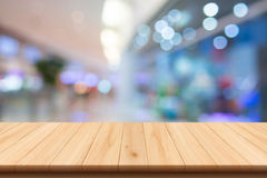 Shopping mall blur background and wooden floor Stock Photography
