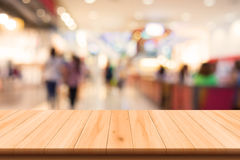 Shopping mall blurred with wooden floor. Shopping mall blurred background with wooden floor Royalty Free Stock Image