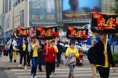 A contingent of billboards on the streets of Shenzhen. The shopping mall carries out a big sale of goods, and the staff of the market hold the billboard in the Stock Photo
