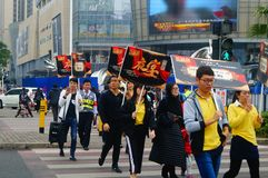 A contingent of billboards on the streets of Shenzhen. The shopping mall carries out a big sale of goods, and the staff of the market hold the billboard in the Royalty Free Stock Photography