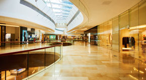 Shopping mall center. Inside retail shopping mall center with stores and shops. Interior of modern business commercial building with fashion shop window royalty free stock photography