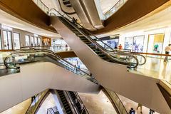 Shopping mall center. Nterior of modern business commercial building. Inside busy city retail shopping mall center hall with fashion stores and shops. People Royalty Free Stock Images