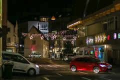 Shopping mall at christmas time with traffic on busy road. In december at south germany night near city of munich and stuttgart Royalty Free Stock Photos
