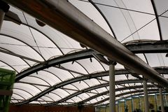 Stretched Fabric Roof on Steel Frame. A shopping mall covered by stretched fabric roofing supported by tubular steel framework, letting in diffused natural light Stock Photography