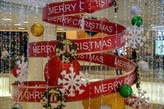Multilevel shopping mall interior decorated with Christmas decoration stock photo