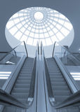 Shopping mall escalator. Toned image of escalator inside shopping mall Royalty Free Stock Photos