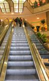 Shopping mall escalator Stock Images