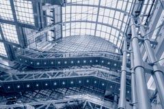 Shopping mall escalator. In buiding Royalty Free Stock Photos