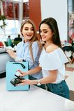 Shopping Mall. Girls Paying With Credit Card. Shopping Mall. Beautiful Girls In Stylish Clothes Paying With Credit Card At Store Checkout. High Resolution Royalty Free Stock Photos