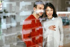 Shopping Mall. Man And Woman Looking Through Store Window. Shopping Mall. Happy Man And Beautiful Woman Smiling And Looking Through Store Window. High Resolution Royalty Free Stock Photo