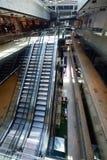 Shopping mall interior  escalator. Modern shopping mall store  interior escalator with lens flare Royalty Free Stock Photos