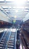 Shopping mall interior  escalator. Modern shopping mall store  interior escalator with lens flare Stock Photos