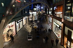 Shopping Mall Interior View. People visit Cabot Circus shopping mall during the Christmas holiday shopping season on November 7, 2014 in Bristol, UK. The mall Royalty Free Stock Photo