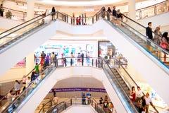 Shopping mall in Kuala Lumpur. KUALA LUMPUR - MAY 12, 2013: People at Suria KLCC in Petronas Twin Towers  in Kuala Lumpur. Suria KLCC is a 1,500,000 sq ft (140 Stock Images