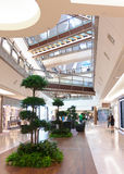 Shopping Mall Malaysia. Center of the Shopping Mall with stairs and plants on the ground floor Royalty Free Stock Photography