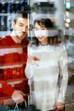 Shopping Mall. Man And Woman Looking Through Store Window. Shopping Mall. Happy Man And Beautiful Woman Smiling And Looking Through Store Window. High Resolution Stock Photos