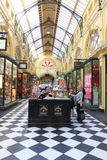 Shopping mall Melbourne. Tourists buying macaron in a historic shopping mall on Collins street Melbourne Australia Stock Photo