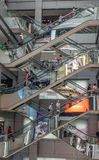 Shopping mall with moving escalators stock images