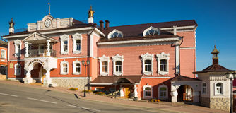 "Shopping mall myshkin editorial. MYSHKIN, RUSSIA – AUGUST 27, 2016: view on shopping mall ""Myshkiny palaty"" in russian style build downhill on street Stock Photos"