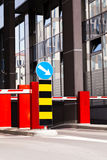 Shopping mall parking entrance. Parking barrier and mandatory way sign, building in background Stock Photo